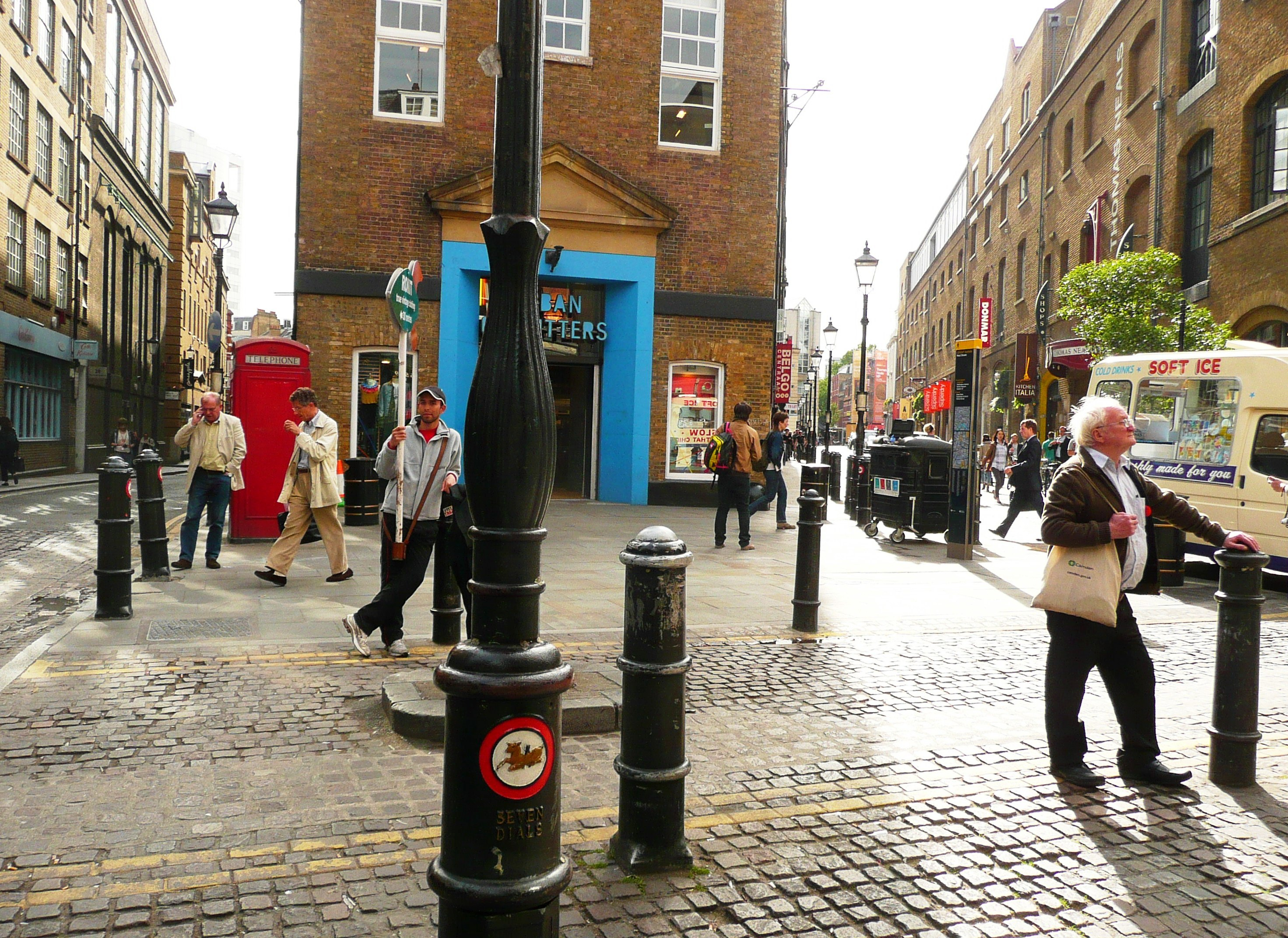 2006 Junction of Neal Street and Earlham Street repaved with York stone, with Seven Dials bollards and lamp posts.