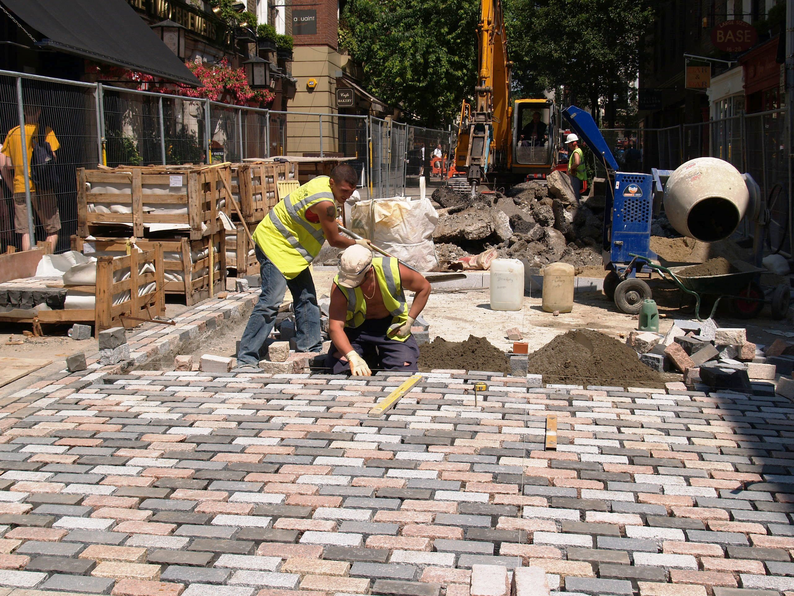 Hand-laying setts.