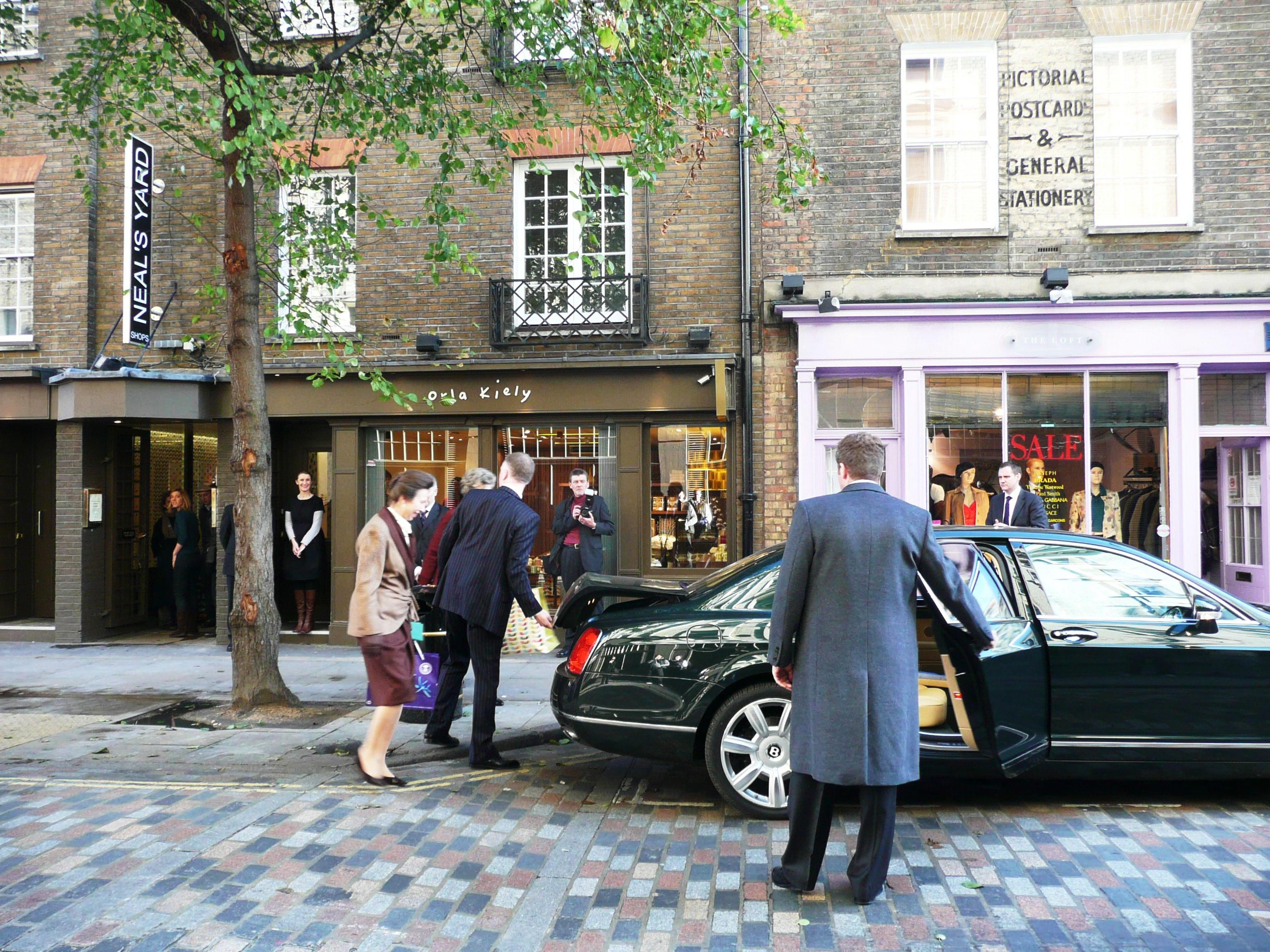 The Princess Royal admires the multi-coloured dressed setts in Monmouth Street.