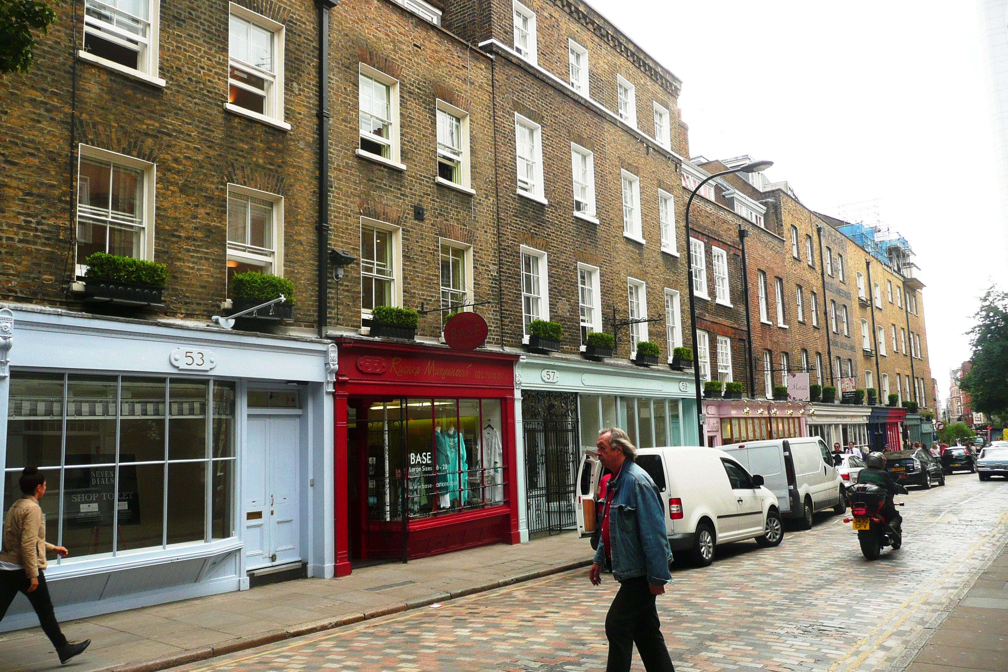 Monmouth Street entablature planters with restrained planting.