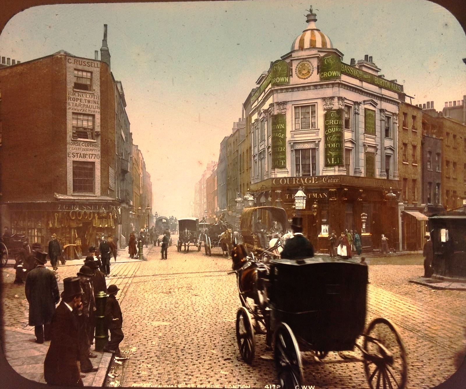 Seven Dials c. 1890, a rare hand-coolored lantern slide acquired by the trust, showing fashio, transport, street surfaces and much else in great detail