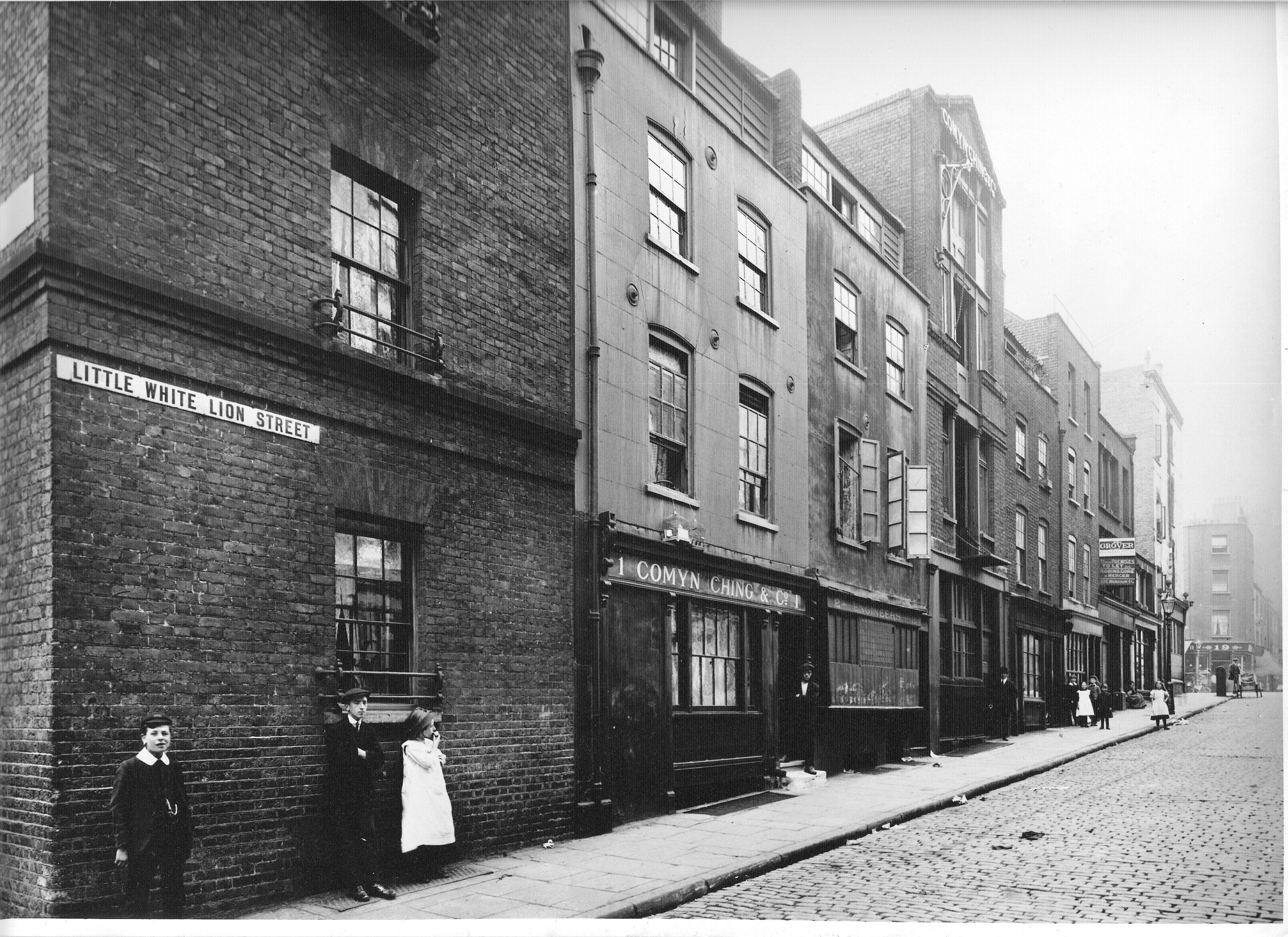 1913 Little White Lion Street, now Mercer Street, showing the hoist at No. 23.