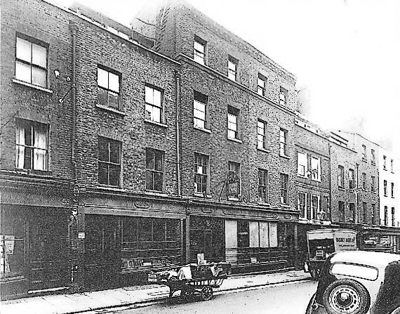 1940s Monmouth Street shopfronts, which were to be beautifully restored in the 1980s.