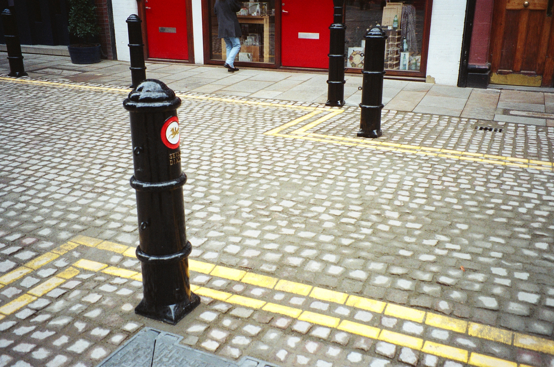 Setts, York stone and Seven Dials bollards.