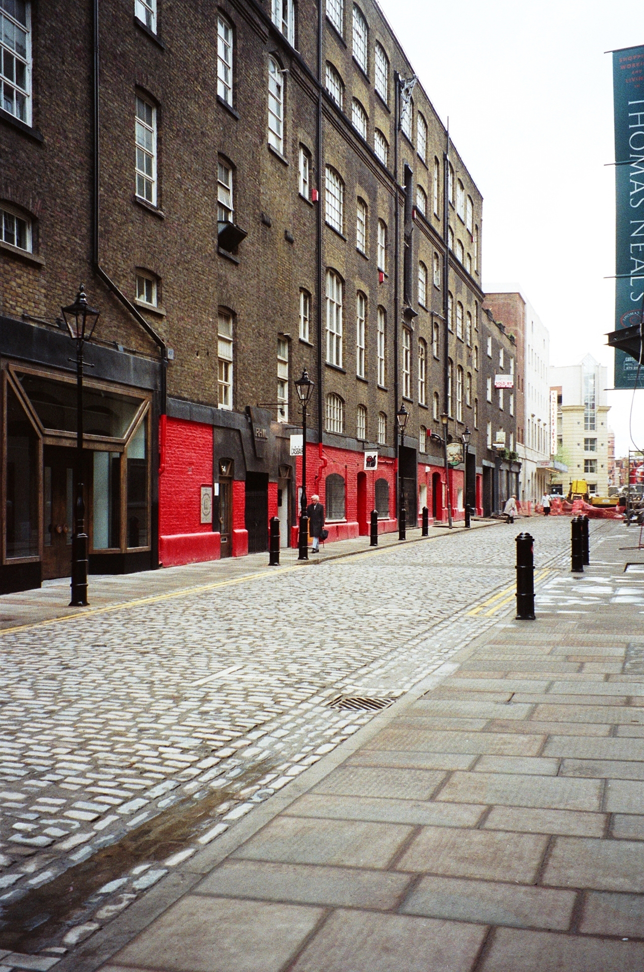 Earlham Street completed, with restored fa�ade of Seven Dials Warehouse.