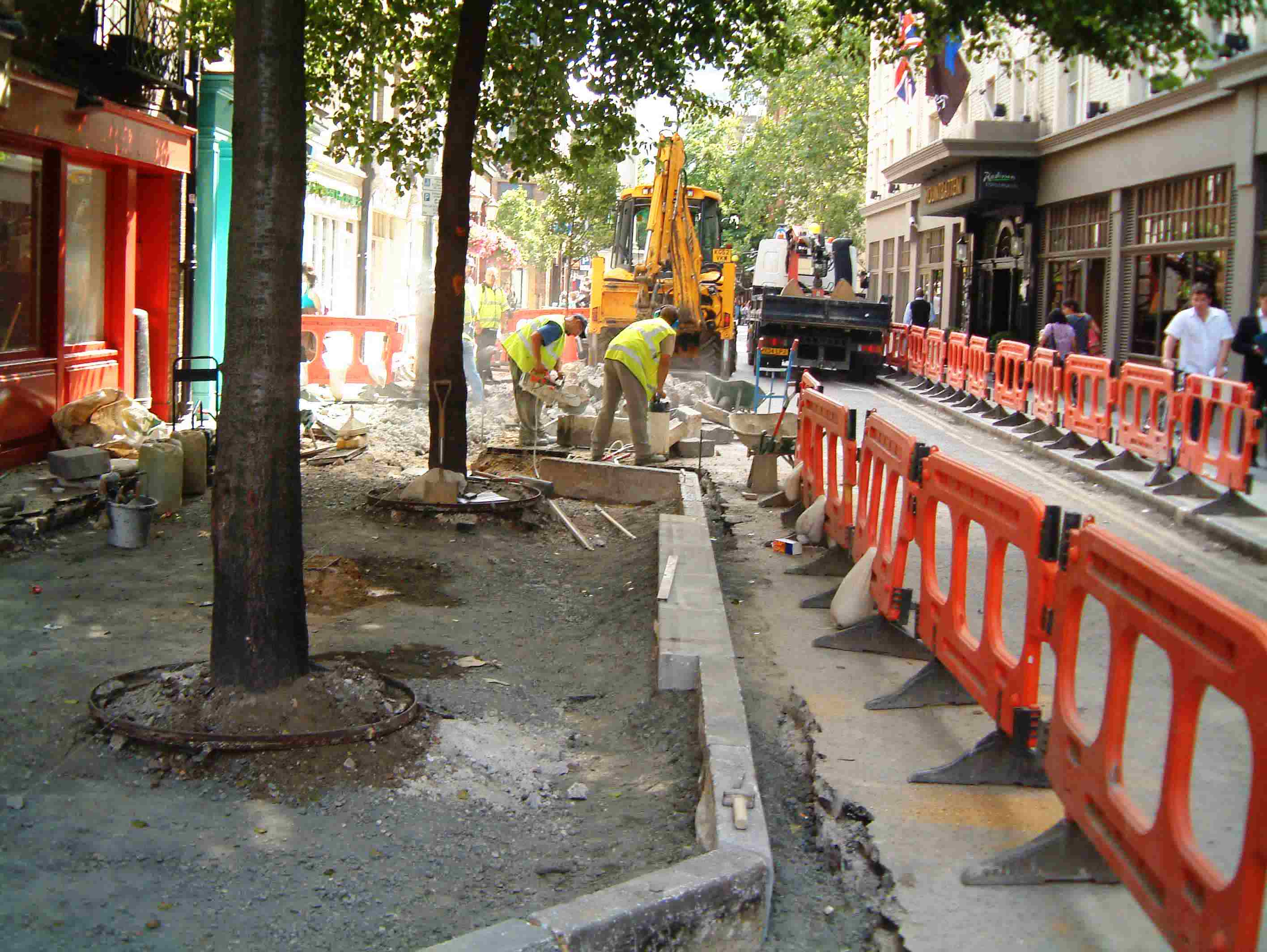 Relaying kerbs to new line and level to enable carriageway works and new levels.