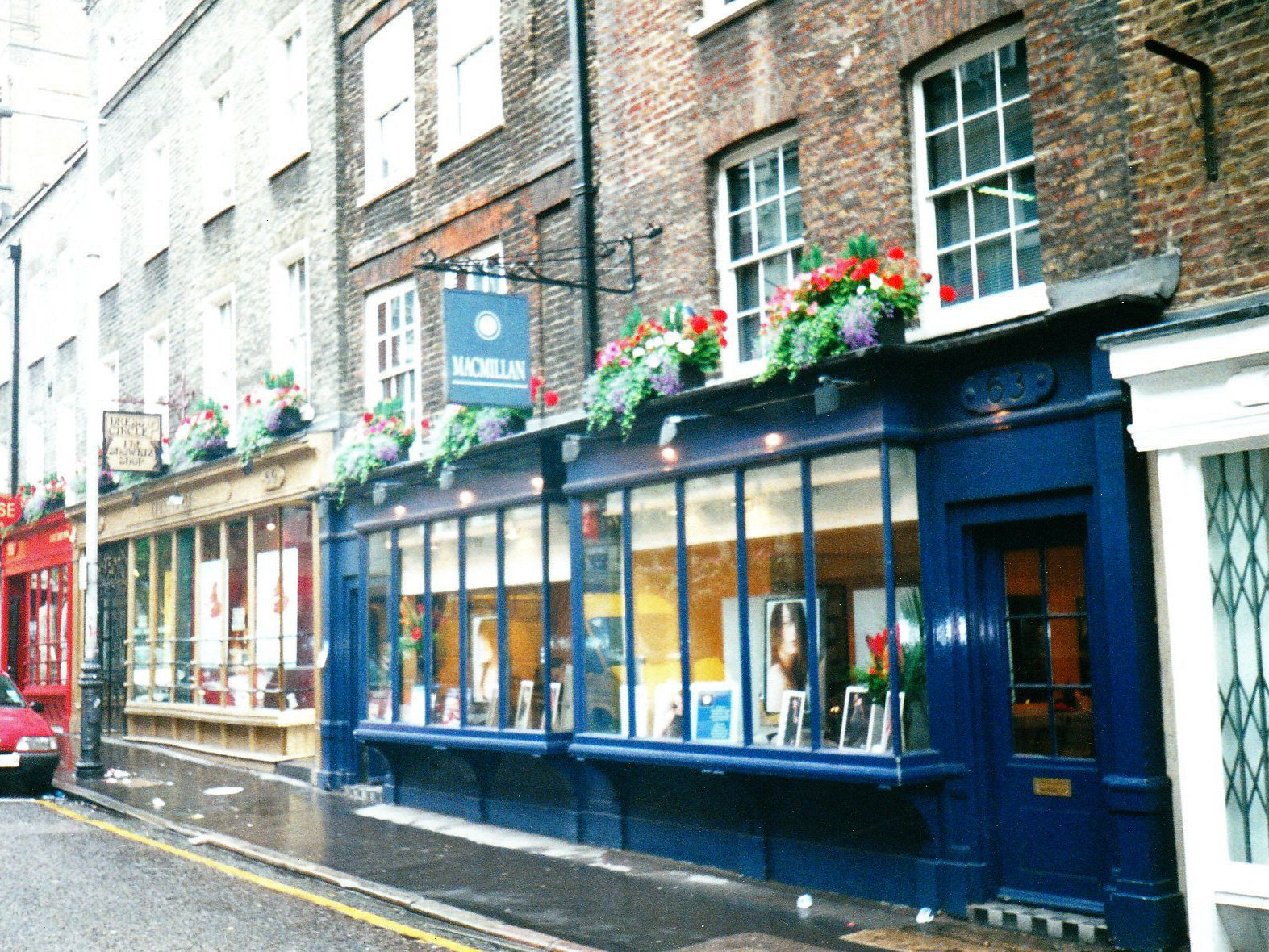 Early nineteenth century shopfronts on Monmouth Street, restored by Shaftesbury PLC.