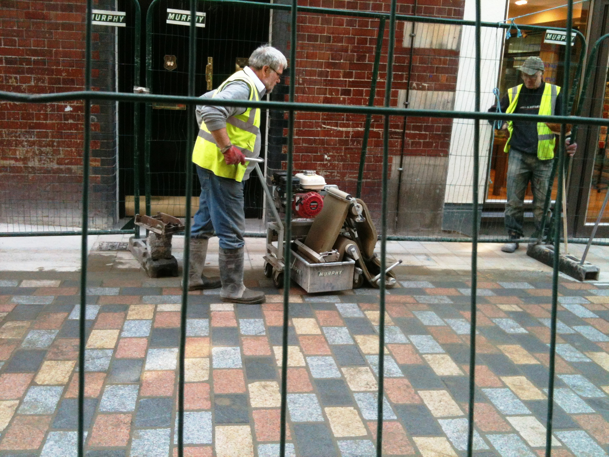 Cleaning the new setts in Mercer Street South.