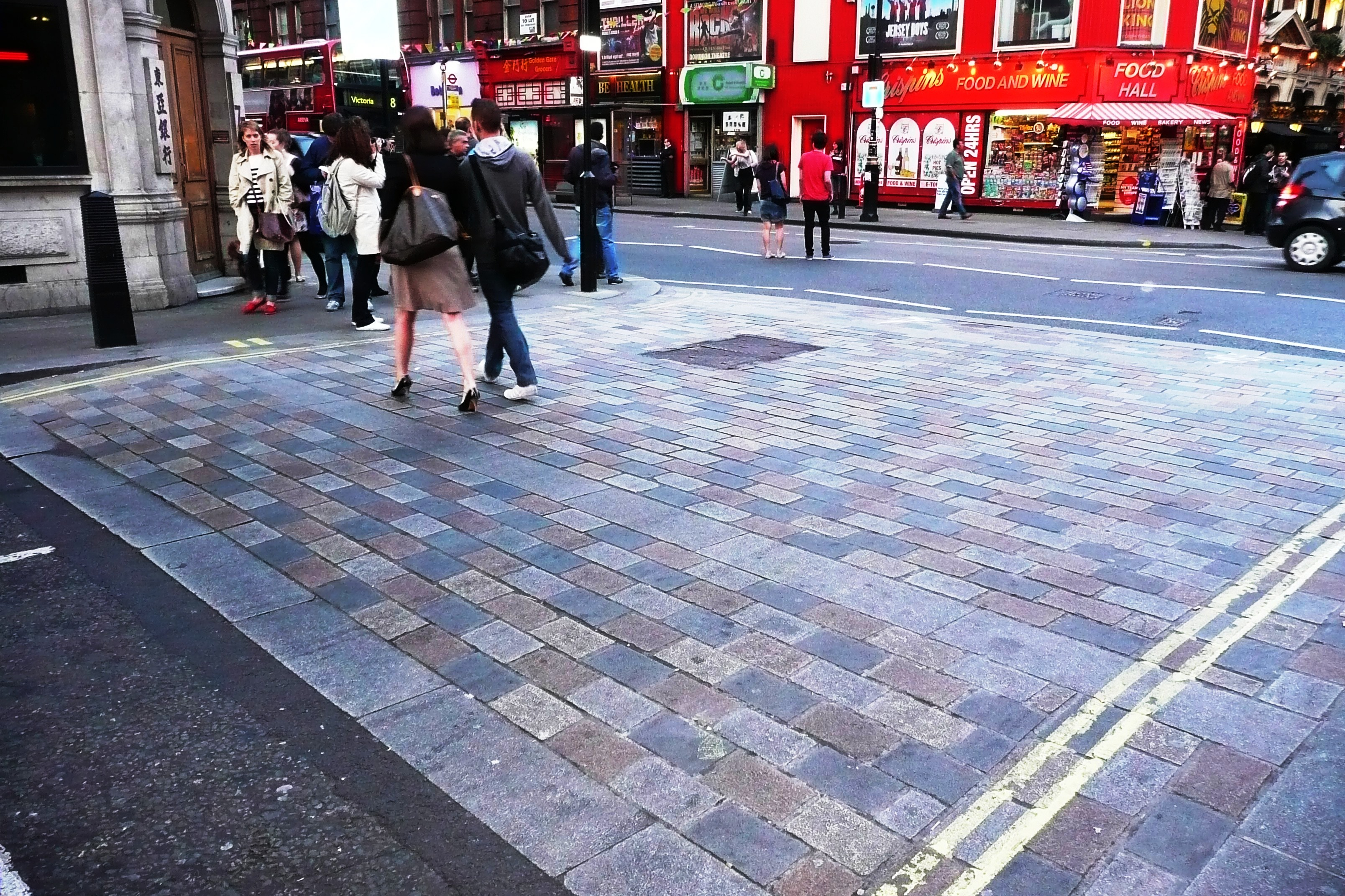 Transport for London's use of multi-coloured dressed setts at the junction of Dean Street and Shaftesbury Avenue, Soho.