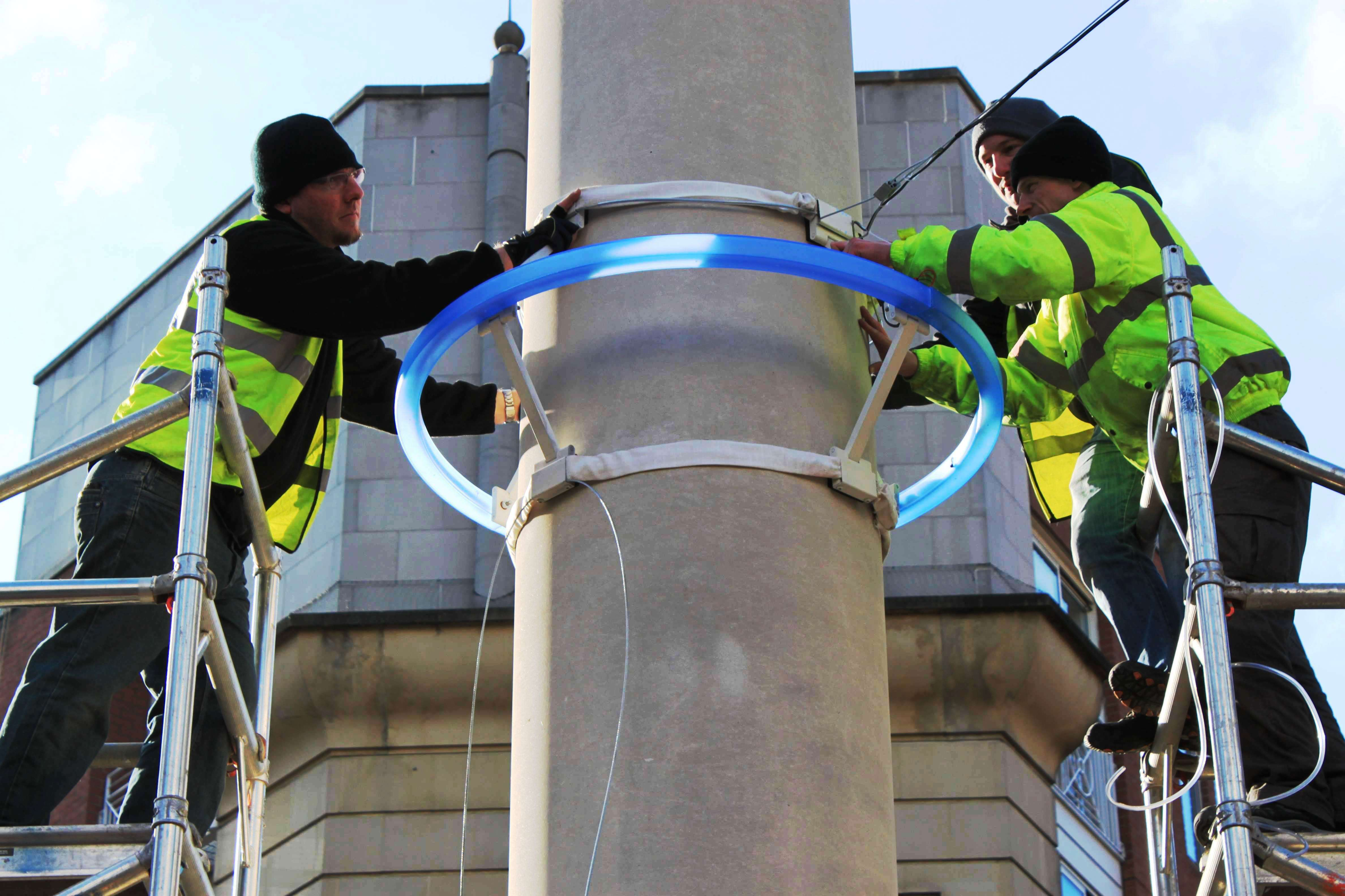 Installing the fluorescent ring.