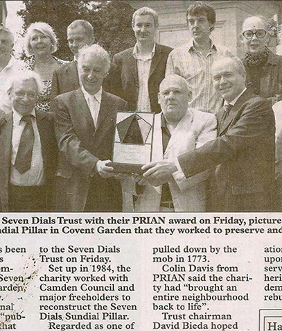 2007 PRIAN Awards::Awarded for projects which have stood the test of time. Beneath the Sundial Pillar - top row trustees and Camden officers, bottom row left to right AD Mason architect Whitfield Partners, Roger Howard structural engineer Hockley & Dawson, Colin Davis PRIAN, David Bieda Trust Chairman, Cllr Keith Moffitt Leader Camden Council, Peter Heath co-author the Seven Dials Renaissance studies.